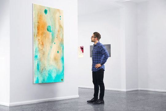 Young man in modern art gallery