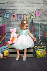 little girl on spring and easter backdrop