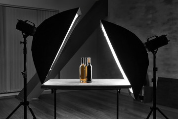 Interior of professional photo studio while shooting bottles