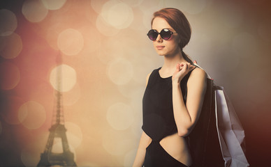 beautiful young woman with shopping bags on the wonderful eiffel tower background