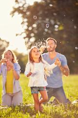 Fun for female child with soap bubbles  .