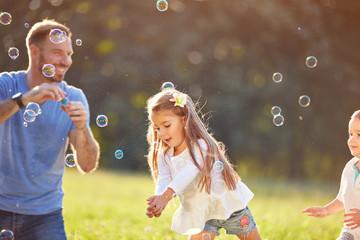 Girl catch soap bubbles outside