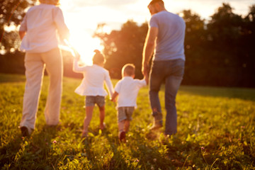 Blurred background of family in nature