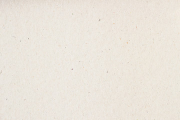 Texture of old organic light cream paper, background for design with copy space text or image. Recyclable material, has small inclusions of cellulose