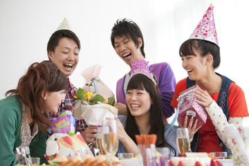 Friends celebrating birthday party together