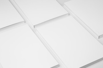 Real paperback white books on a gray background