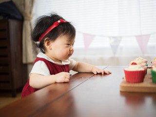 baby girl eating cup cake