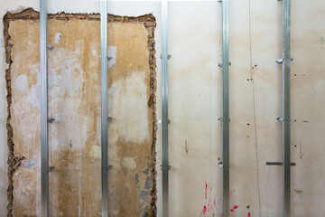 Interior of apartment with materials during on the renovation and construction ( making wall from drywall)