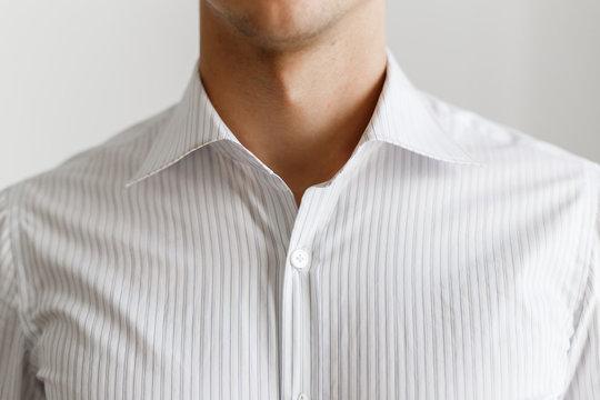 White shirt on the businessman. Unbuttoned collar. Beautiful elegant shirt. Close up view