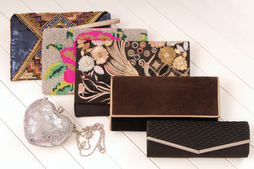 an assortment of female handbags, show-window and fashionable clutchs,