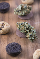 Cannabis nugs over infused chocolate chips cookies - medical marijuana edibles concept
