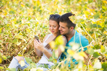 Portrait of a young loving couple in a field of soya beans