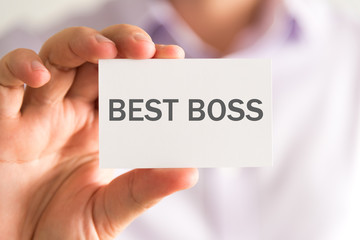 Businessman holding a card with BEST BOSS message