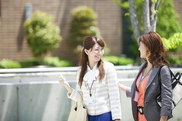 Two young businesswomen walking