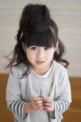 Girl holding a key