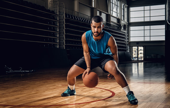 Professional basketball player in an action in basketball field.