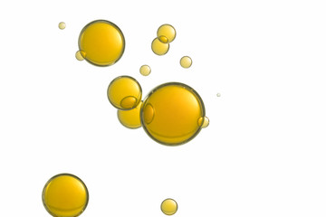 Beautiful yellow bubbles is isolated over a white background