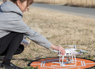 woman setting drone in outdoor