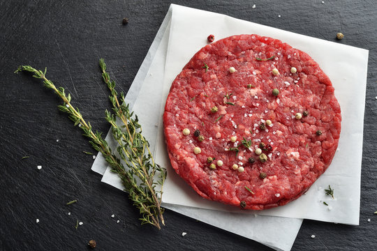 Fresh raw Prime Black Angus beef burger patty