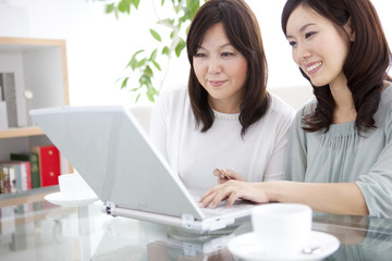 Mother and daughter on-line shopping