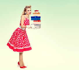 Woman in pin-up style red dress with gift boxes