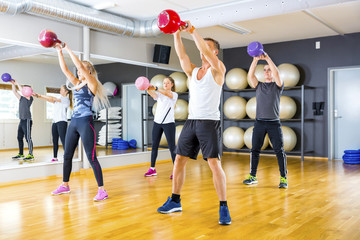 Focused team trains with kettlebells at fitness gym
