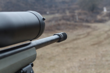 Sniper rifle. Optical sight. Shooting at the dash.