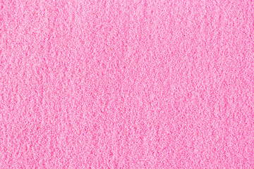 Beautiful pink decorative sand scattered on the table.
