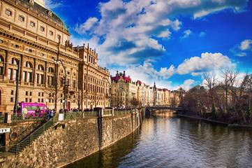 Old building with watch near the river Vltava in Prague, Czech Republic