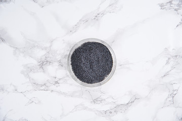Top view of a blue poppy seeds in a bowl