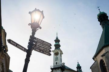 Sign post streetlight and townhall tower of Banska Stiavnica, Slovakia at dusk, UNESCO site