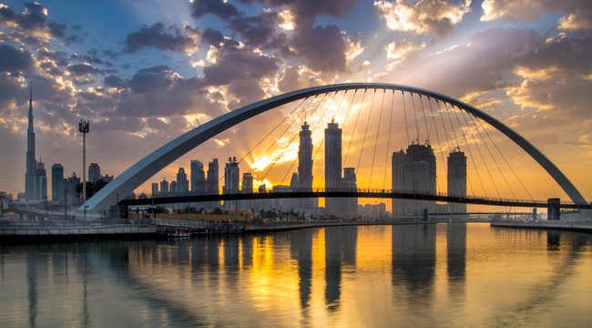 Dubai, UAE - March 4, 2017: Magical sunrise over Dubai Downtown as viewed from the Dubai water canal