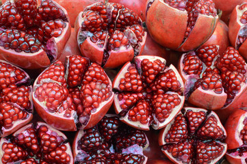 Fresh pomegranates with seeds sold in the local market of Bangkok, Thailand