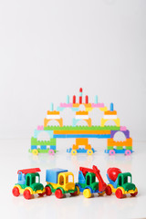 Bright, colorful cars. On a white background. Stuff is made from clay.