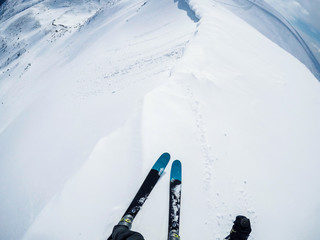 skier freerider on mountain peak ready for pure powder ride