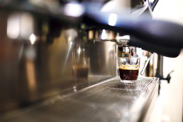 Espresso being prepared from coffee machine.
