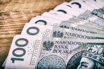 Polish currency PLN, money. File roll of banknotes of 100 PLN (P