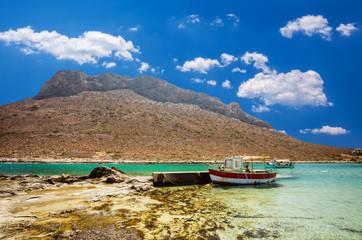 Stavros beach on Crete island, Greece. Fishing boats waiting in Stavros bay.