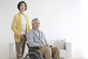 Senior man in wheelchair and senior woman