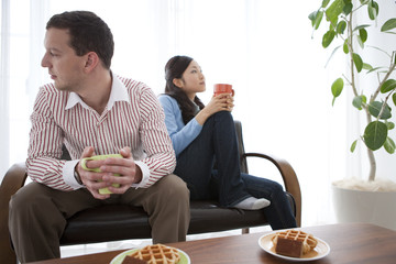 Couple Having Snack in Living Room
