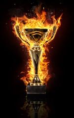 Burning gold trophy cup on black background