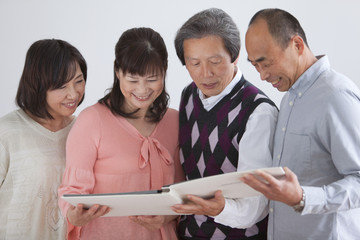Couples looking at photo album
