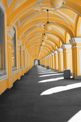Long street gallery with arches, round lights, light and shadow