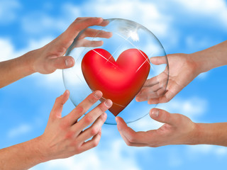 Health insurance or the concept of life, of love.People's hands holding a transparent sphere with a heart inside