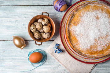German Easter cake on a platter and quail eggs