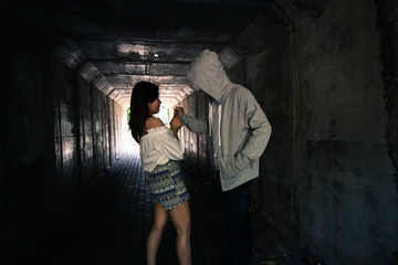 Social Issues,Beautiful woman walking in the tunnel and being attack by stalker