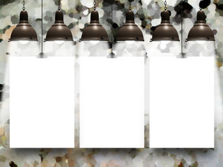 Three blank frames with lamps against abstract background