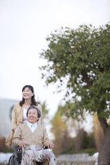 Mature Woman and her Husband in Wheelchair