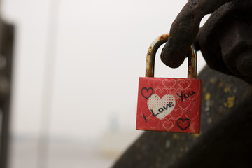 Romantic Sign a red love Lock on an old chain on an anchor