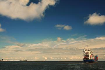 Cargo ship leaving Gdynia harbor. Poland. Europe.